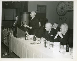 Photograph of Thomas Head Raddall making an address at the 25th anniversary dinner of the Mersy P...