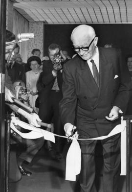 Photograph of H.P. McKeen cutting a ceremonial ribbon