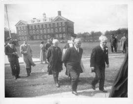 Photograph of several unidentified people walking across Studley campus