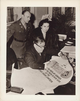 Photograph of Ellen Ballon, Fiorello H. LaGuardia, and unidentified man in uniform
