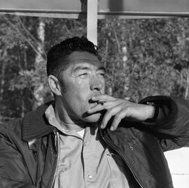 Photograph of Dick Field smoking a cigarette