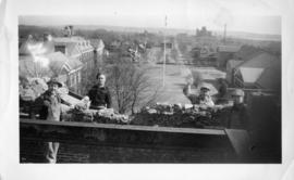 Photograph of men working on a stone wall on the Arts & Administration Building