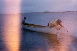 Photograph of two men fishing in a canoe near Fort Chimo, Quebec