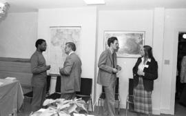Photograph of four unidentified people mingling at the opening of the Ocean Studies house