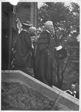 Photograph of A. S. MacKenzie and others on the front steps of the Forrest Building