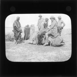 Photograph of unidentified soldiers and a group of people
