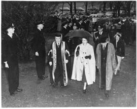 Photograph of Dr. Kerr, Princess Elizabeth, and Colonel Laurie walking past naval cadets