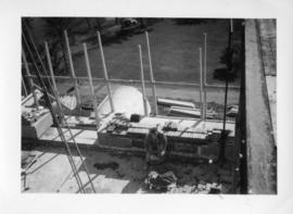 Photograph of a bricklayer on the Arts & Administration Building construction site