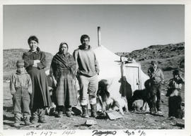 Photograph of a family standing outside of their house in Port Burwell, Northwest Territories