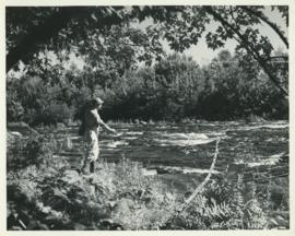 Photograph of Thomas Head Raddall fishing near Trout Rock at the foot of Lake Falls on the Mersey...