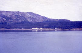 Photograph of a house on the shore of Davis Inlet, Newfoundland and Labrador
