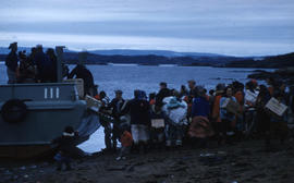 Photograph of packages being unloaded from a boat in Frobisher Bay, Northwest Territories