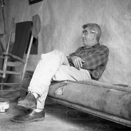 Photograph of Blackie McGowan sitting on a couch
