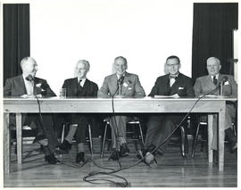 Photograph of five people at miscellaneous health-related event