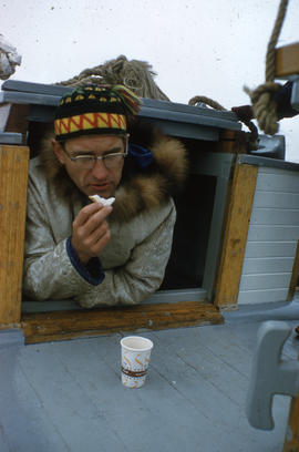 Photograph of Bob Green on a boat in Frobisher Bay, Northwest Territories