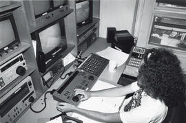 Photograph of person in editing suite
