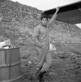 Photograph of Jean-Mari Girard standing with his hand on the wing of an airplane