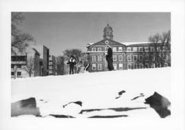 Photograph of people skiing next to the Henry Hicks Arts & Administration Building