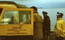 Photograph of three men and a truck in Frobisher Bay, Northwest Territories