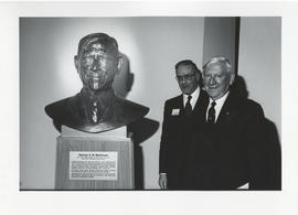 Photograph of Norman A. M. MacKenzie with a bust of himself and an unidentified man