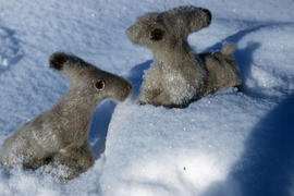 Photograph of two rabbit figurines made of fur from Port Burwell, Northwest Territories