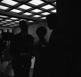 Photograph of three unidentified people in the Tupper Building