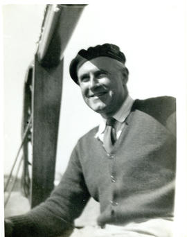 Photograph of Thomas Head Raddall aboard the yacht Ripple