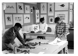 Photograph of three men making prints in Cape Dorset, Northwest Territories