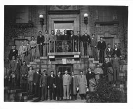 Photograph of a class of medicine students on the front steps of the Public Health Clinic