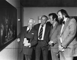 Photograph of Henry Hicks and guests at the Svoboda exhibit reception