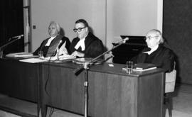 Photograph of three unidentified people at a law award presentation
