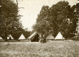 Two officers in front of the tents