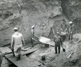 Photograph of five men digging into the permafrost in Fort Chimo, Quebec