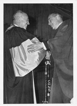Photograph of Henry Hicks conferring an honorary degree on Dr. Ogden Glass