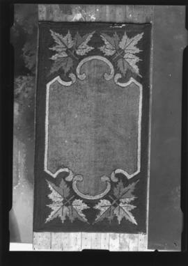 Photograph of a hooked rug commissioned by Mr. Frank Garrrett