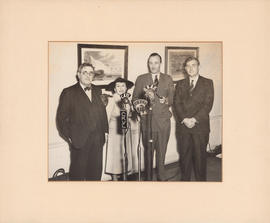 Douglas Clarke, Ellen Ballon, Frank Cyril James, and unknown man : [photograph]