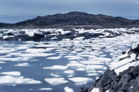 Photograph of ice floes and hills in Frobisher Bay