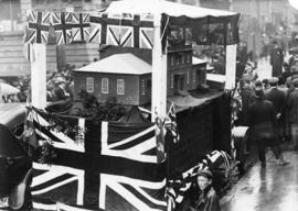 Photograph of a parade float bearing a model of the original Dalhousie College conveying the buil...