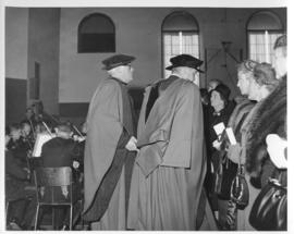 Photograph of two unidentified people in robes