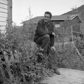 Photograph of Black Douglas Jackson sitting on a fence