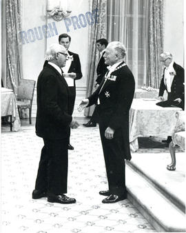 Photograph of Thomas Head Raddall shaking hands with Governor General Michener while being presen...