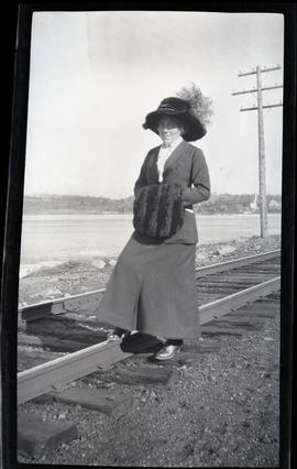 A woman stepping on the train track
