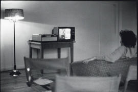 Photograph of a person watching television