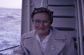 Photograph of a woman wearing glasses and a tan coat in Newfoundland and Labrador