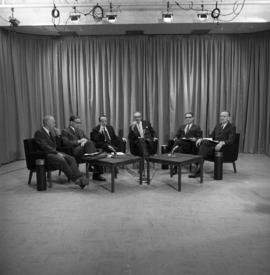 Photograph of a panel of six unidentified people