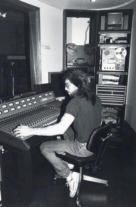 Photograph of person in audio suite