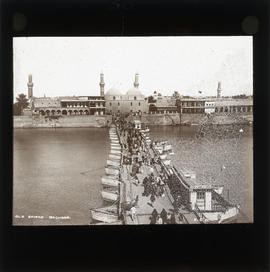 Photograph of people crossing old bridge, Baghdad