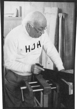 Photograph of Henry Hicks sawing wood
