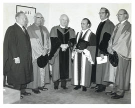 Photograph of Thomas Head Raddall and two other recipients of an honorary doctorate with the chan...