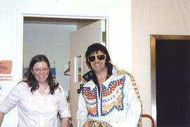 Photograph of Librarian Shelley McKibbon and Elvis impersonator smiling